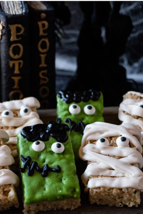 Mummy and Frankenstein Treats with a spooky background