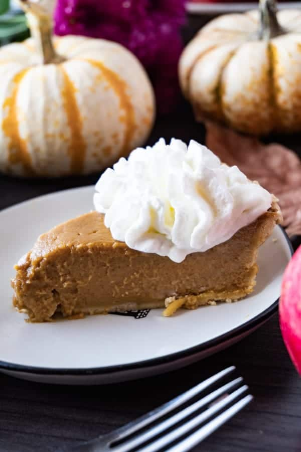 The most creamy and delicious Homemade Pumpkin Pie you have ever tasted! #atablefullofjoy #pumpkinpie #thanksgiving #pie #bestpie #pumpkin #pumpkineverything