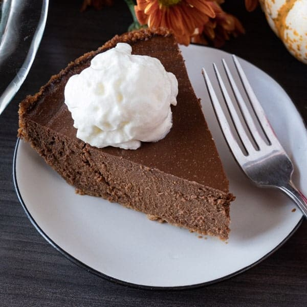 This chocolate pumpkin pie is an easy spin on the classic pumpkin pie. Rich and chocolaty- you can't go wrong! #atablefullofjoy #chocolate #chocolatepie #chocolatepumpkinpie #pie #pumpkinpie #thanksgiving
