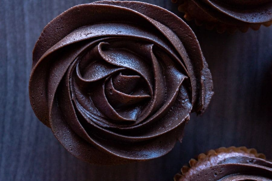 Dark Chocolate Frosting, an easy and delicious frosting that you will want to make again and again. If you enjoy chocolate than you will love this dark chocolate frosting! #frosting #easy #buttercream #darkchocolate #atablefullofjoy #homemade #chocolatefrosting