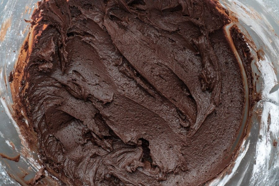 Chocolate frosting in mixing bowl