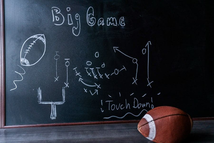 Football Party calkboard with a play drawn on it