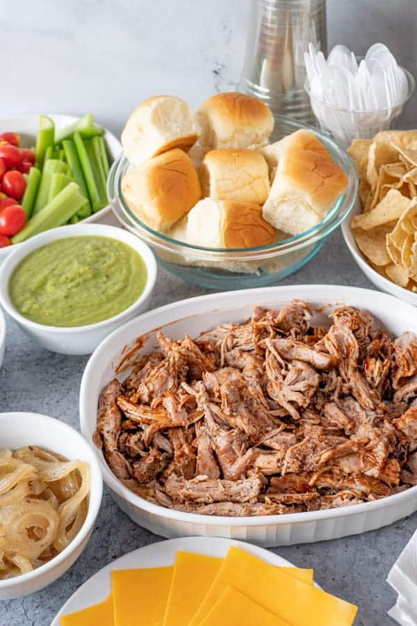 Coca-Cola Pulled Pork in bowl with other party food