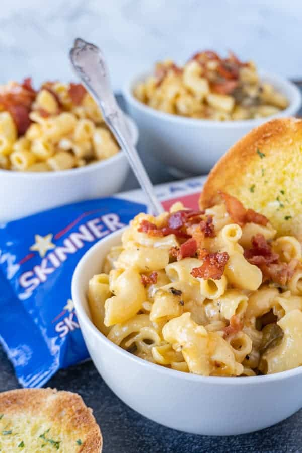 Mac and Cheese in bowl with pasta bag in background