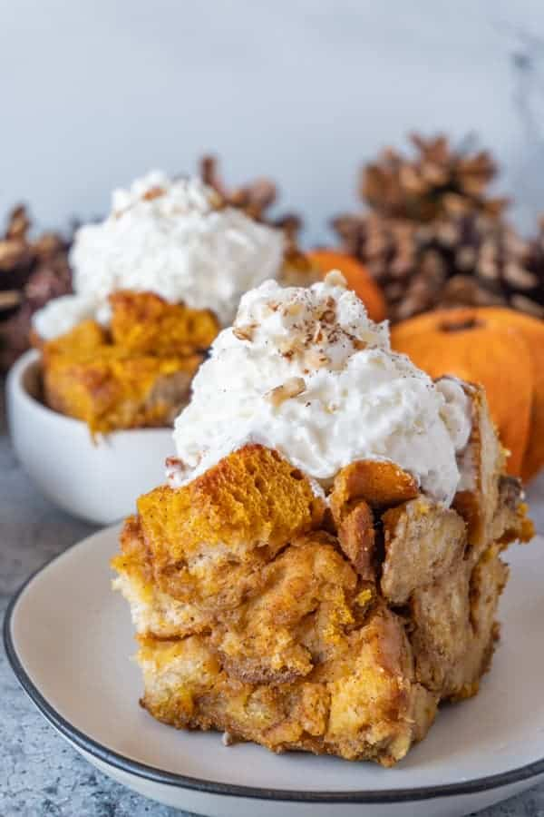 Pumpkin Bread Pudding, close up with whipped cream on top