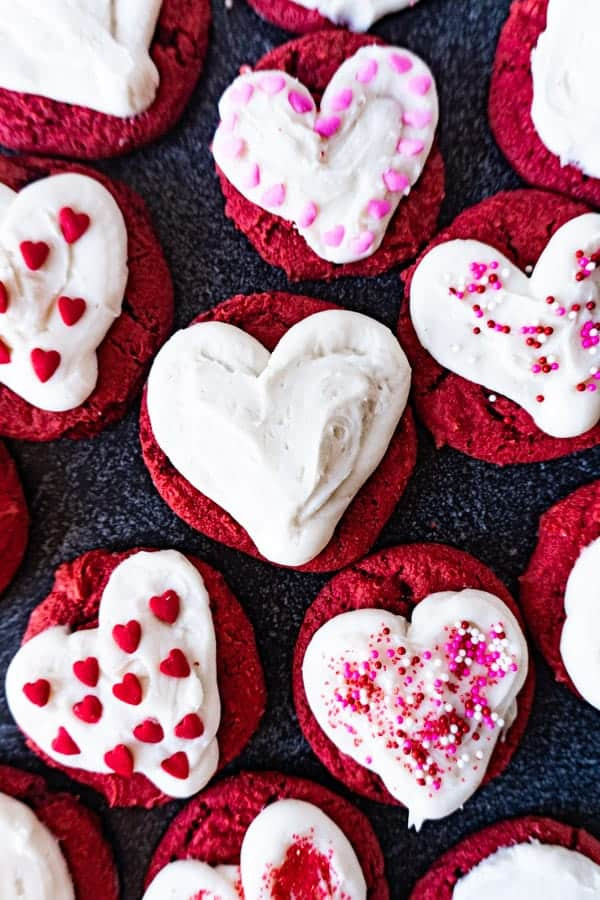 Red Velvet Cookies from cake mix with frosting piped into hearts