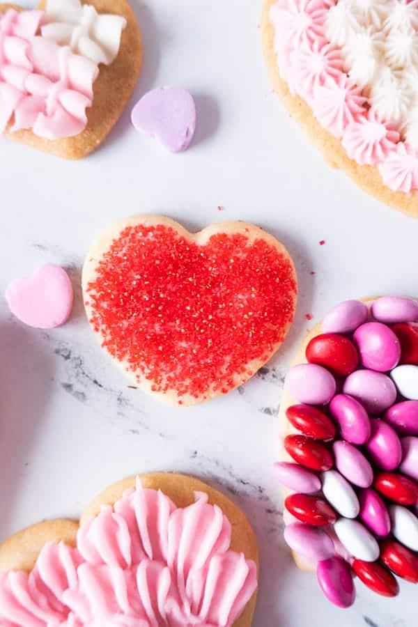 Valentine's Sugar Cookies baked with sprinkles on it