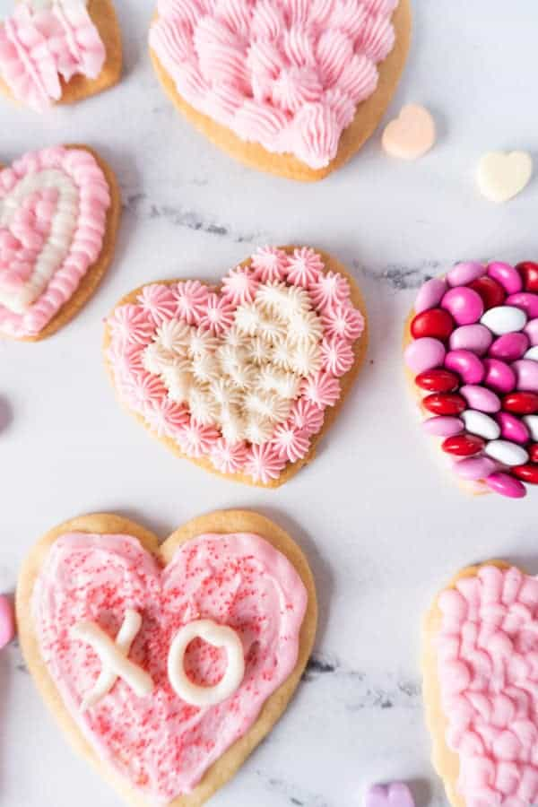 Valentine's Sugar Cookies decorated with dots and sprinkles